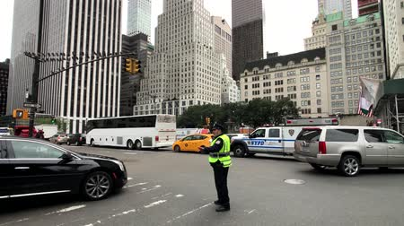 police department : New York, USA - September 6, 2018: Policeman regulates traffic on the streets of Manhattan