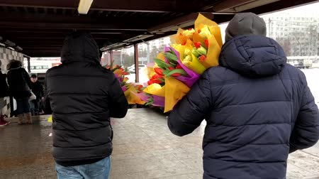 レディース : Moscow, Russia - April 23, 2018: Men bought a lot of flowers as a gift for their women 動画素材