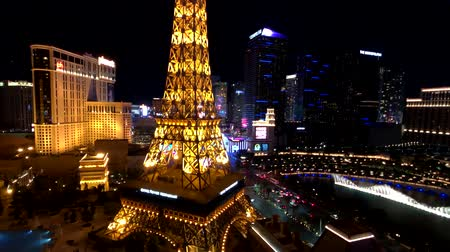 eiffel : Las Vegas, USA - September 10, 2018: Eiffel tower at Paris casino aerial view from Ballys hotel at night, show of music Bellagio fountains, cityscape Stock Footage