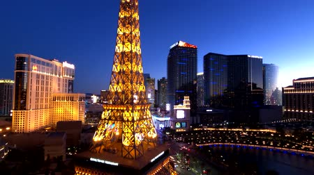 реплика : Las Vegas, USA - September 10, 2018: Eiffel tower at Paris casino aerial view from Ballys hotel at night