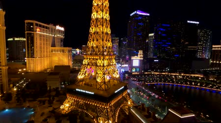 neon lights : Las Vegas, USA - September 10, 2018: Eiffel tower at Paris casino aerial view from Ballys hotel at night