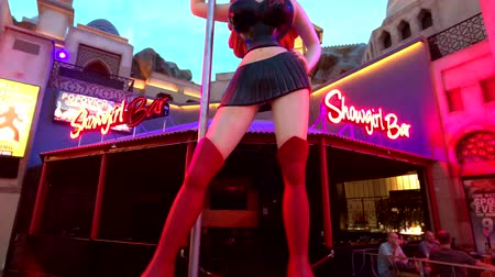striptérka : Las Vegas, USA - September 10, 2018: Huge stripper statue at the Showgirls bar