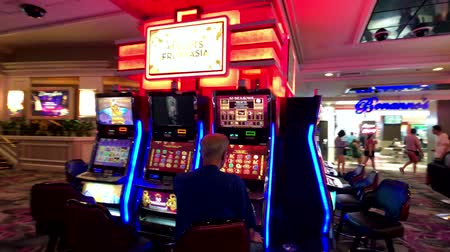 ruleta : Las Vegas, USA - September 10, 2018: People are playing slot machines at MGM casino