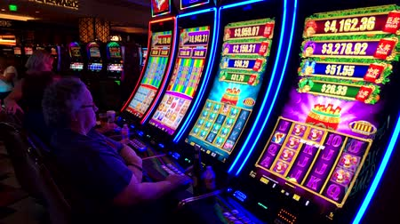 ruletka : Las Vegas, USA - September 10, 2018: People are playing slot machines at MGM casino
