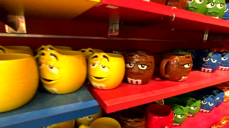 mms : Las Vegas, USA - September 10, 2018: Funny cups for sell at M&MS World Candy Store at the Strip