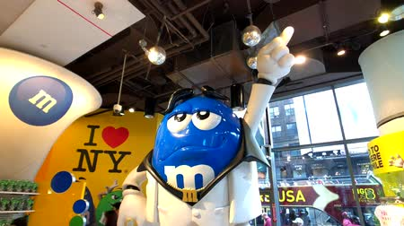 mms : Ne York, USA - September 10, 2018: People attend M&MS World Candy Store at Times Square