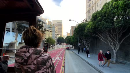 tramwaj : San Francisco, USA - September 10, 2018: Tourists riding retro tram at day time