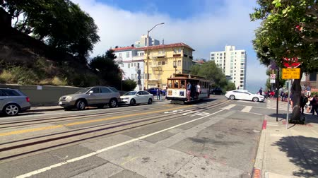 tramway : San Francisco, USA - September 10, 2018: Tourists riding retro tram at day time