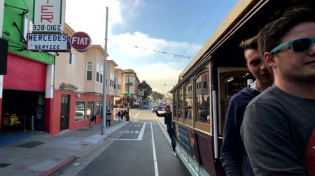 tranvía : San Francisco, USA - September 10, 2018: Cityscape at sunny day time, pov view from riding retro tram