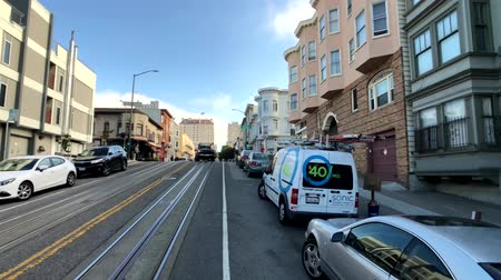 troli : San Francisco, USA - September 10, 2018: Cityscape at sunny day time, pov view from riding retro tram