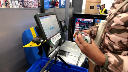 walmart : Chicago, USA - September 10, 2018: Female buyer uses self-service terminal in Walmart supermarket Stock Footage