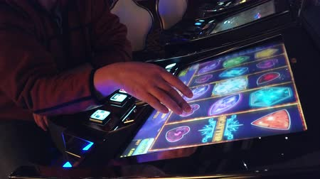 štěrbina : Las Vegas, USA - September 10, 2018: Man playing slot machine in casino