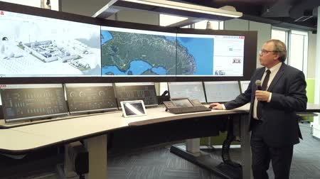 toezicht : Kaliningrad, Russia - April 10, 2019: Engineering monitoring system with multiple screens demonstration