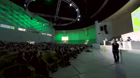 listener : Skolkovo, Russia - April 16, 2019: People attend business forum in large congress hall