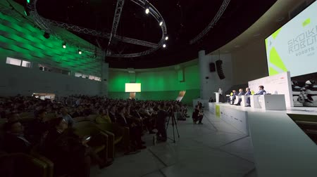 kongres : Skolkovo, Russia - April 16, 2019: People attend business forum in large congress hall