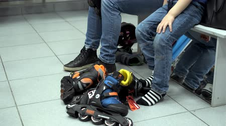 denemek : Pyatigorsk, Russia - April 19, 2019: Mother and son try on sports shoes and roller skates in a sports store