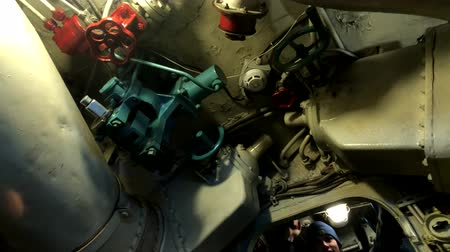 donanma : Kaliningrad, Russia - April 12, 2019: Man explores the interior of an old submarine.