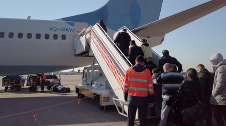 economico : Moscow, Russia - April 19, 2019: Passengers are boarding on the aircraft of low cost airline company Pobeda