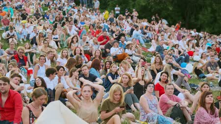 concert crowd : Moscow - June 22, 2019: People attend open-air concert at International Jazz Festival Usadba Jazz in Kolomenskoe Park
