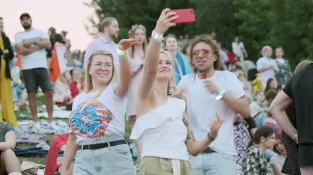fan fest : Moscow - June 22, 2019: People attend open-air concert at International Jazz Festival Usadba Jazz in Kolomenskoe Park