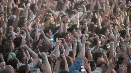 fan fest : Moscow - June 22, 2019: Crowd of fans cheering at open-air music festival, defocused Stock Footage