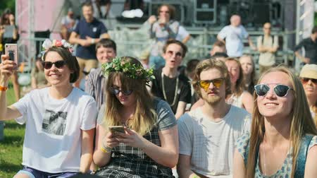 rock festival : Moscow - June 22, 2019: People attend open-air concert at International Jazz Festival Usadba Jazz in Kolomenskoe Park
