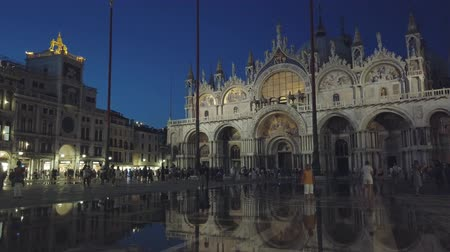 saint mary : Venice, Italy - August 4, 2019: Tourists sightseeing in Venices most famous square San Marco at evening time