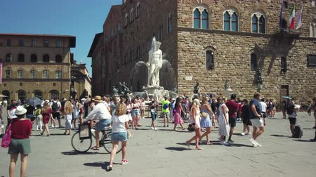 palazzo : Florence, Italy - August 1, 2019: Tourists visiting the most famous attractions and monuments in old city