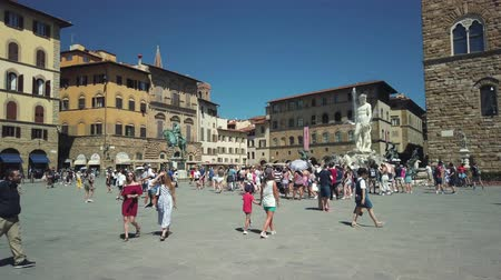 florence : Florence, Italy - August 1, 2019: Tourists visiting the most famous attractions and monuments in old city