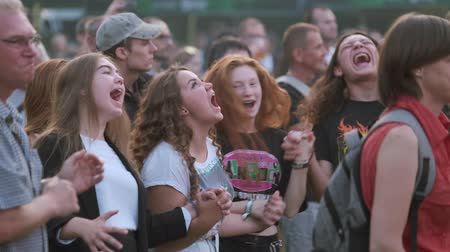 junho : Moscow - June 22, 2019: Teenager girls cheering at open air rock concert Vídeos
