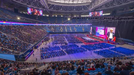 listener : Saint Petersburg, Russia - October 4, 2019: Panorama of the business forum at the indoor stadium, timelapse