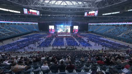 congress : Saint Petersburg, Russia - October 4, 2019: Businessmen attend large educational forum at Gazprom Arena Stadium
