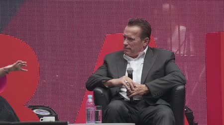 governor : Saint Petersburg, Russia - October 4, 2019: Arnold Schwarzenegger, famous actor, politician and businessman, speaks at a business forum