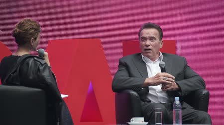ator : Saint Petersburg, Russia - October 4, 2019: Arnold Schwarzenegger, famous actor, politician and businessman, speaks at a business forum