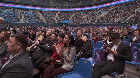 congreso : Saint Petersburg, Russia - October 4, 2019: Business conference attendees sit and listen to lecturer at large satdium
