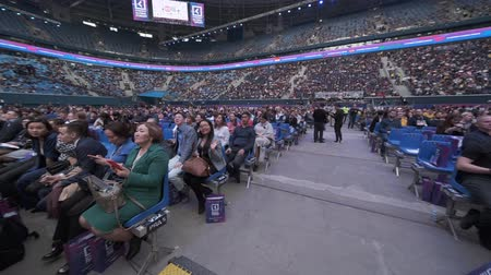 briefing : Saint Petersburg, Russia - October 4, 2019: Business conference attendees sit and listen to lecturer at large satdium