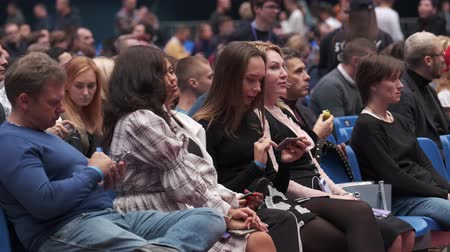 participants : Saint Petersburg, Russia - October 4, 2019: Business conference attendees sit and listen to lecturer at large satdium