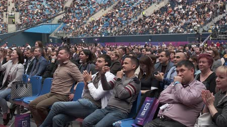 フォーラム : Saint Petersburg, Russia - October 4, 2019: Business conference attendees sit and listen to lecturer at large satdium