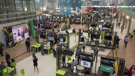 население : Skolkovo, Russia - October 21, 2019: Visitors to the business forum move around the exhibition space, top view