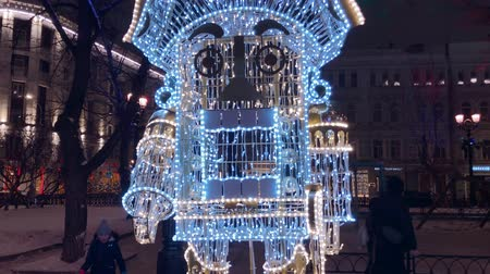 Moscow, Russia - December 24, 2019: City street decorated with illumination for Christmas at evening