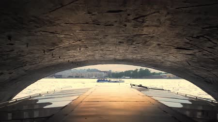 Passing under bridge in Saint Petersburg. Shot from a tour boat. Slow motion