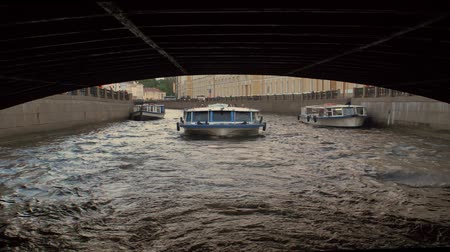 бортовой : Passing under bridge in Saint Petersburg. Shot from a tour boat. Slow motion