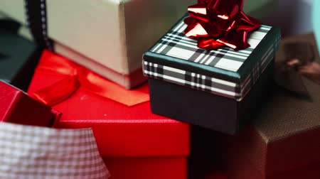 Set of gift boxes of different sizes and colors. Dolly Shot. 4K Filmati Stock