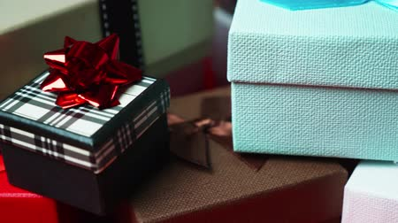 Set of gift boxes of different sizes and colors. Dolly Shot. 4K Stock mozgókép