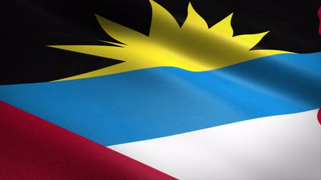 Flag of Antigua and Barbuda. Waving flag with highly detailed fabric texture seamless loopable video. Seamless loop with highly detailed fabric texture. Loop ready in 4K resolution