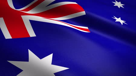 Flag of Australia. Waving flag with highly detailed fabric texture seamless loopable video. Seamless loop with highly detailed fabric texture. Loop ready in 4K resolution Stock mozgókép