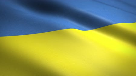 Flag of Ukraine. Waving flag with highly detailed fabric texture seamless loopable video. Seamless loop with highly detailed fabric texture. Loop ready in 4K resolution Stock mozgókép