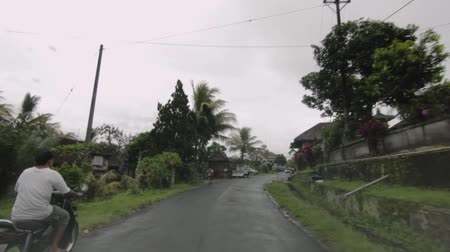 hyperlapse clip of a journey through a stretch of road in a Balinese village