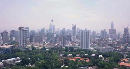 Aerial view of Malaysia, Kuala Lumpur of trees, parks and city skyline with tall skyscrapers