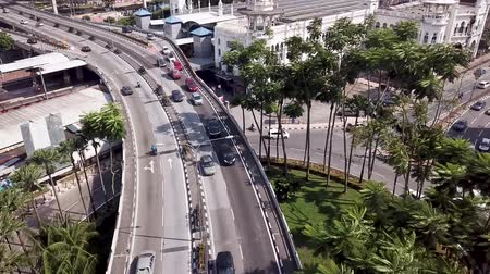 Aerial view in Malaysia, Kuala Lumpur of roads with cars and old KTM railway train station